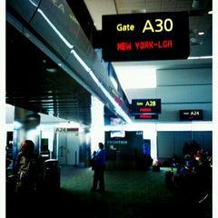 Photo taken at Gate A30 by Teresa d. on 2/8/2012
