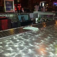 Photo taken at Throwbacks Grille & Bar by Adam J. on 2/10/2012