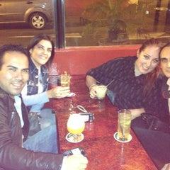 Photo taken at PiscoBar Restobar by Elvira C. on 7/29/2012