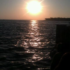 Photo taken at Mallory Square by Debbie H. on 4/5/2012