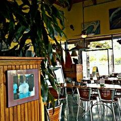 Photo taken at Big Wave Cafe by Erik B. on 6/18/2012