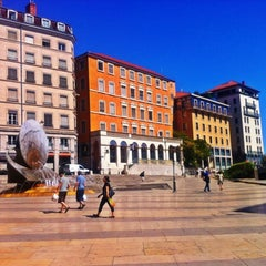 Photo taken at Place Louis Pradel by Alexi T. on 8/18/2012