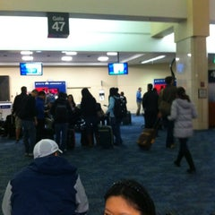 Photo taken at Gate 47 by Nahoko I. on 3/28/2012