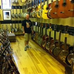 Photo taken at Gruhn Guitars by Luigi C. on 6/13/2012