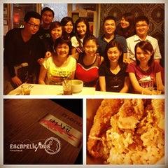 Photo taken at Umami Cafe by Elaine L. on 7/26/2012