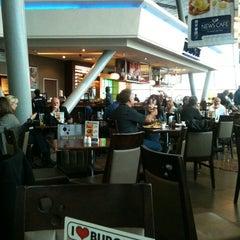 Photo taken at News Cafe by Karoline W. on 5/30/2012