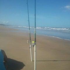 Photo taken at Praia Da Costa by Itana M. on 2/18/2012