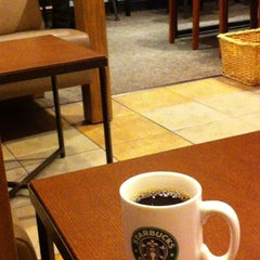 Photo taken at Starbucks Coffee 神田駅前店 by Ryuzy on 3/28/2012