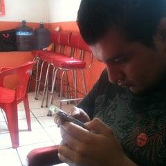 Photo taken at Los Cuñados by Erika N. on 9/1/2012