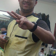 Photo taken at Dominguez Barbershop by Marcos S. on 3/16/2012