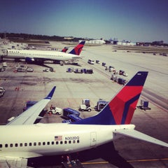 Photo taken at Delta Sky Club by John R. on 4/9/2012