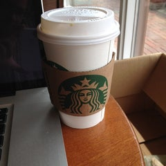 Photo taken at Starbucks by Erin M. on 5/13/2012