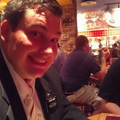 Photo taken at Red Robin Gourmet Burgers by Chelsea H. on 2/12/2012