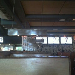 Photo taken at Faenza Pizza & Grill by Luiz G. on 7/31/2012