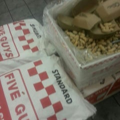 Photo taken at Five Guys by Derek S. on 9/3/2012