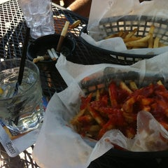 Photo taken at JP Looney's Sports Bar And Grill by Ashley B. on 6/26/2012