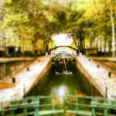 Photo taken at Canal Saint-Martin by Baptiste M. on 8/23/2012