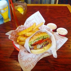 Photo taken at Red Robin Gourmet Burgers by Bruce K. on 7/19/2012