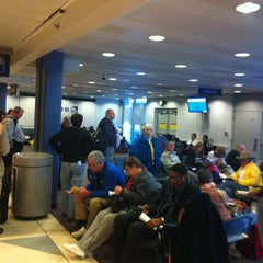 Photo taken at Gate G4 by edward r. on 2/11/2012