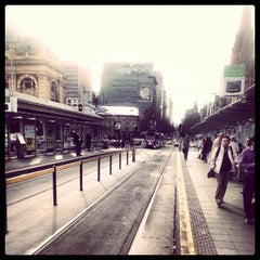 Photo taken at Tram Stop 13 - Federation Square (3/3a, 5, 6, 16, 64, 67, 72) by Abdullah K. on 7/31/2012