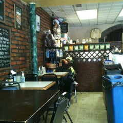 Photo taken at Isabella's Brick Oven Pizza & Panini by Ace K N. on 4/25/2012