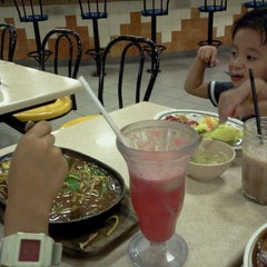 Photo taken at Arena Food Court by Tuty I. on 3/4/2012