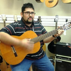 Photo taken at Austin Vintage Guitars by Sheikha M. on 7/12/2012