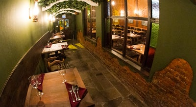 Photo of Restaurant The Raven at R. Sarmento Leite, 969, Porto Alegre 90070-150, Brazil