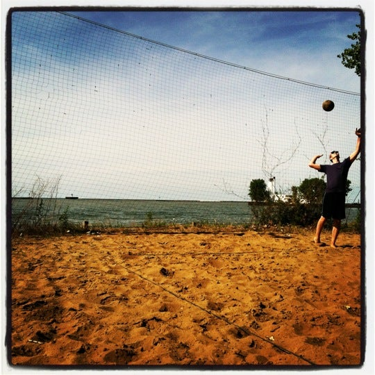 Photo taken at Whiskey Island Volleyball Courts by Emma B. on 6/23/2012