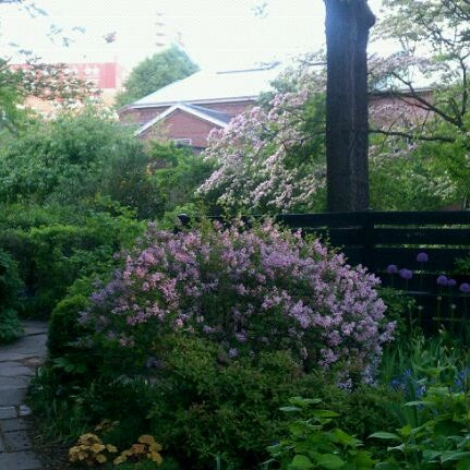 Photo taken at The Garden at St. Luke in the Fields by Moish F. on 5/10/2011