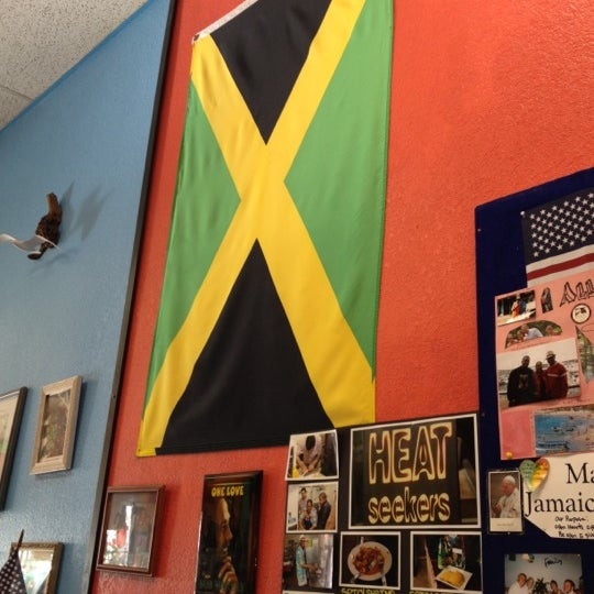 Photo taken at Mama Jamaica's Kitchen by Justin C. on 3/6/2012