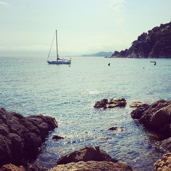 Photo taken at Cala Canyelles by Bayo E. on 8/6/2014