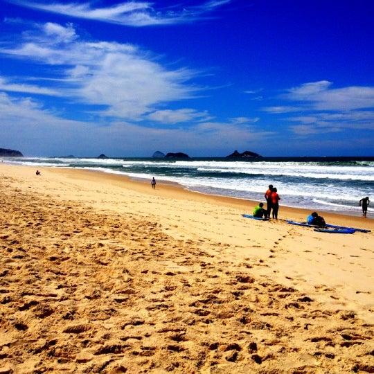 Photo taken at Praia da Barra da Tijuca by Roberto E. on 9/30/2012