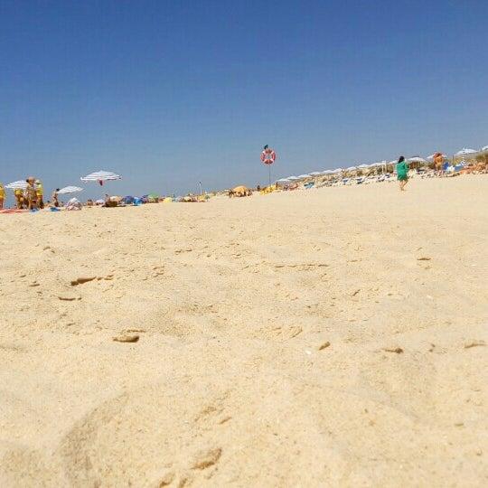 Photo taken at Praia do Barril by Bruno C. on 6/18/2016
