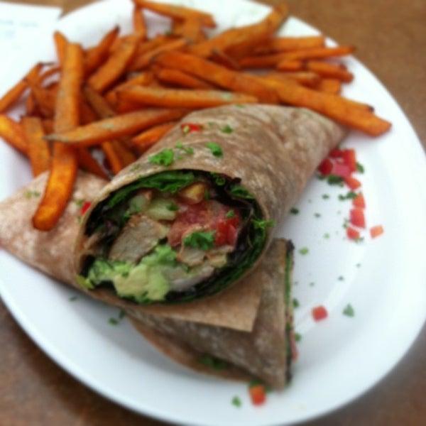 Photo taken at Native Foods Café by Alex S. on 3/4/2013