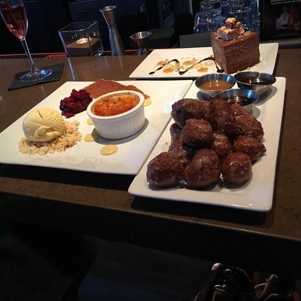 Photo taken at Crave Dessert Bar & Lounge by Katie M. on 8/12/2016