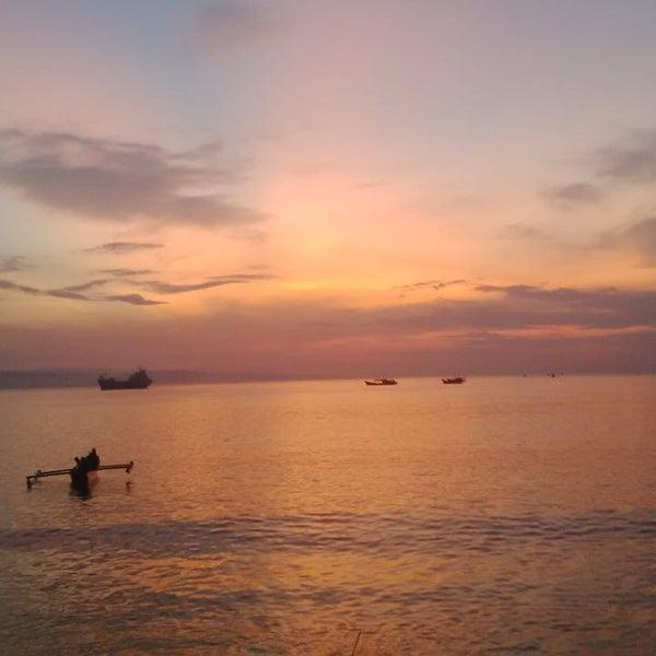 Photo taken at Pantai Barat Pangandaran by Rifqi B. on 4/4/2015