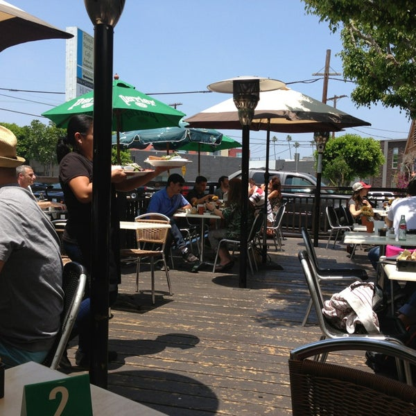Photo taken at French Market Café by Eva R. on 7/4/2013