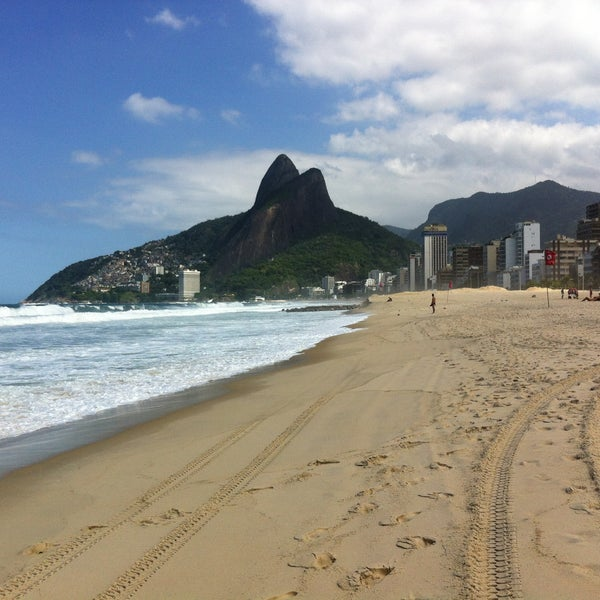 Photo taken at Praia de Ipanema by Juan R. on 4/18/2013