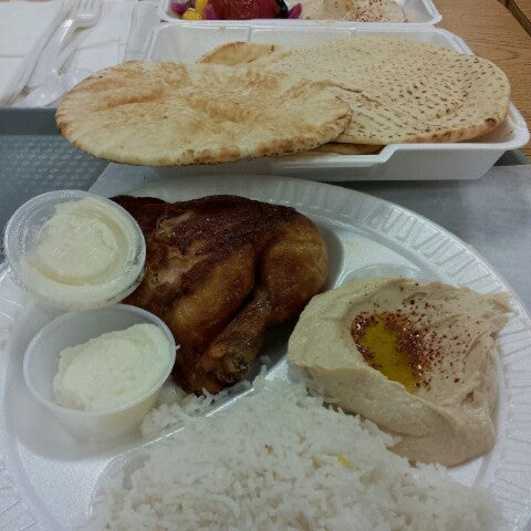 Photo taken at Zankou Chicken by Rhamela V. on 12/29/2012