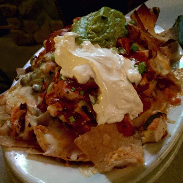 Nachos. Nice and cheesy. Very good. Chipotle chicken was hot sauce and chicken. Hot sauce took away from flavor. Wouldn't get that again.