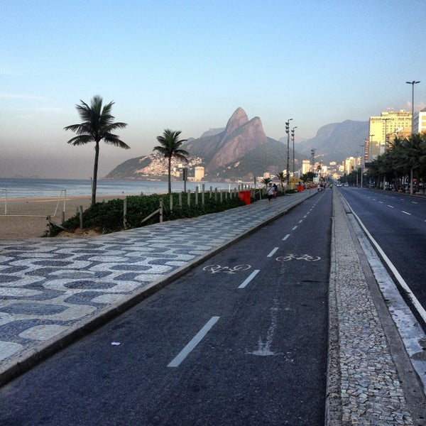 Photo taken at Praia de Ipanema by Luiz M. on 5/3/2013