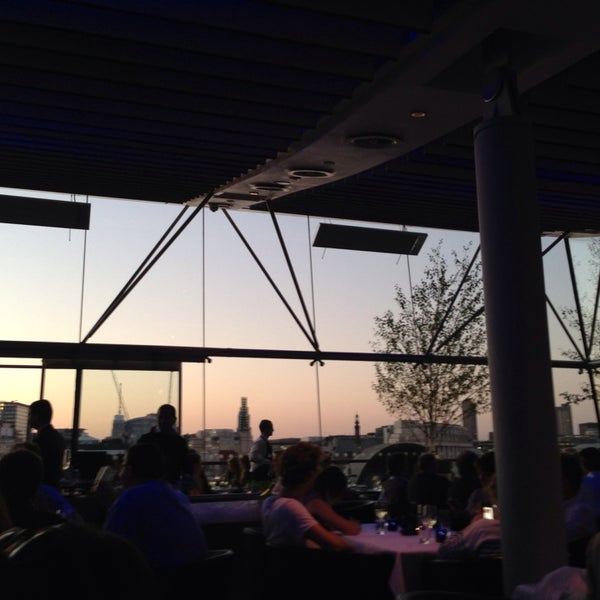 Photo taken at OXO Tower Brasserie by Enis K. on 7/18/2013