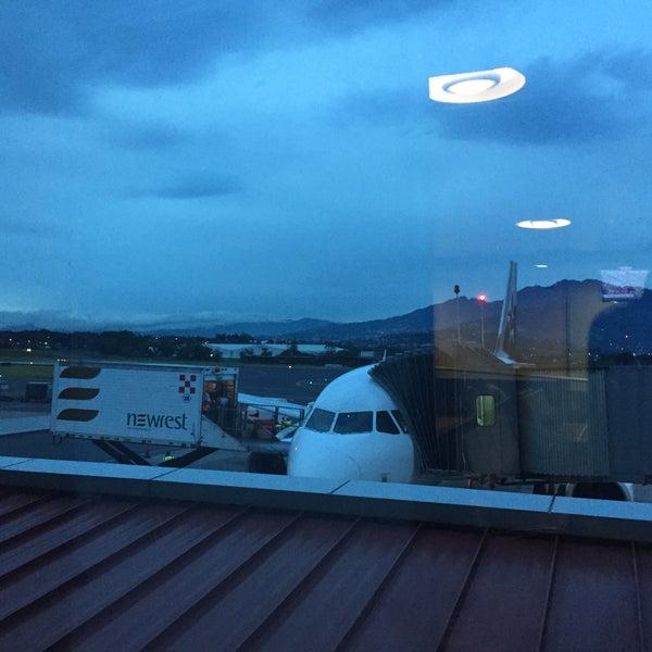 Photo taken at Gate 5 Aeropuerto Internacional Juan Santamaria by Poio V. on 9/11/2015