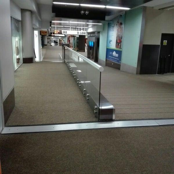 Photo taken at Gate 5 Aeropuerto Internacional Juan Santamaria by Carlos E. on 2/22/2016
