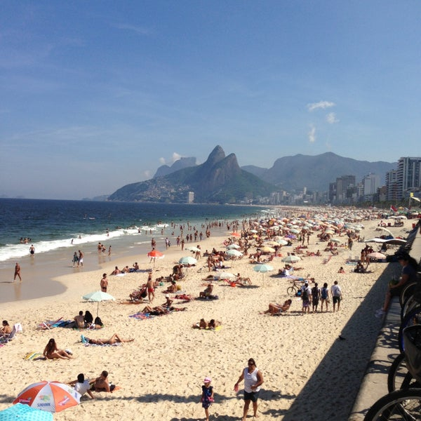 Photo taken at Praia de Ipanema by Rodrigo B. on 5/1/2013