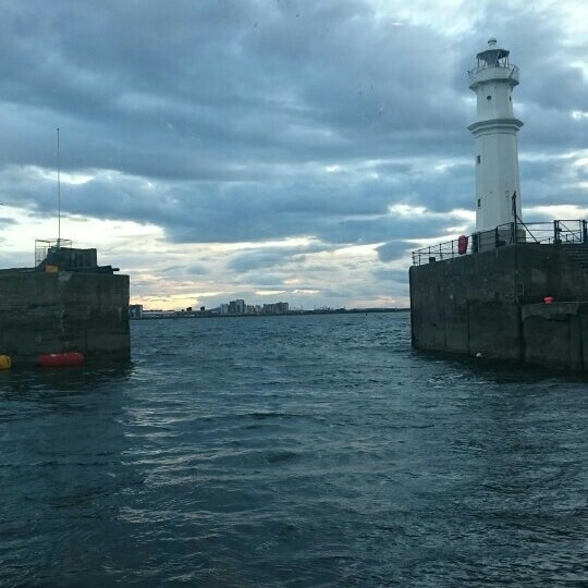 Photo taken at Newhaven Harbour by Andy W. on 5/29/2015