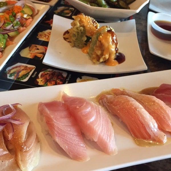 Photo taken at Sushi Tomo by Briana R. on 8/29/2015