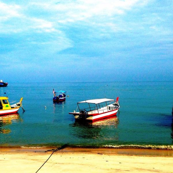 Photo taken at Teluk Bahang Beach by Dave R. on 12/10/2014