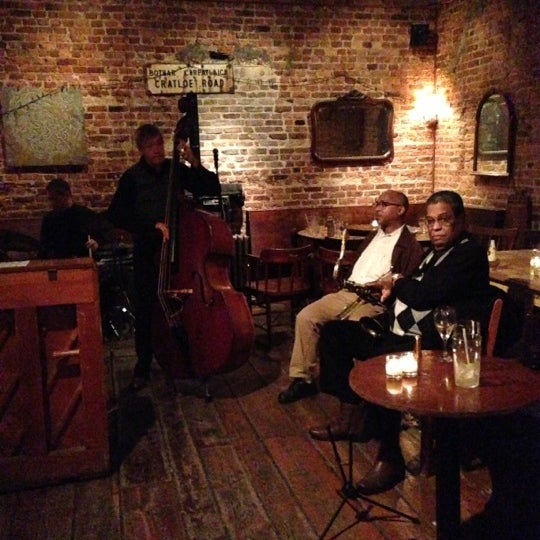 Photo taken at 11th Street Bar by Bethany J. on 12/11/2012